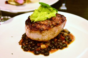 Berkshire pork chop, black bean tinga, orange ginger glaze, spiced avocado