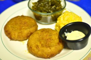 Crab cakes with collard greens and macaroni and cheese