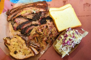 Ribs up top, brisket, pulled pork, turkey on the left, plus bread and cole slaw