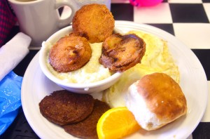 Elle's southern breakfast - fried green tomatoes, grits, eggs, biscuit, sausage