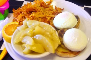 Crab cakes benedict with homes fries and hot cinnamon apples